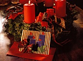 Christmas Wreath with Burning Candles and Invitations