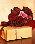 A wrapped present and red roses