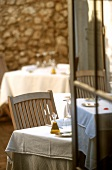 Tables awaiting guests on the terrace of a French-Mediterranean style bistro