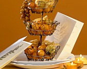 Tiered stand filled with fruit as table decoration