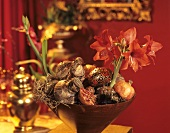 Bowl of amaryllis, pomegranate, onion and tree ornament