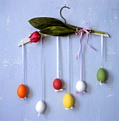 Easter eggs hanging on a coat hanger