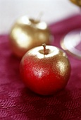 Two gilded apples as table decoration