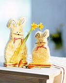 Easter Bunny with narcissi as table decoration
