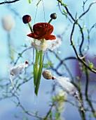 Ranunculuses in hanging vase on Easter tree