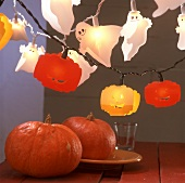 Two pumpkins and Halloween lamps