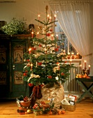 Presents under Christmas tree in a room