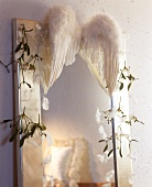Christmas decoration: mirror trimmed with angel's wings & twigs