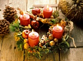 Rustic Advent wreath with burning candles