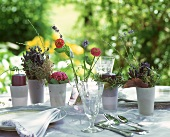 Table laid in shades of delicate violet on garden terrace