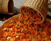 Marigold flowers (Calendula) in wicker basket