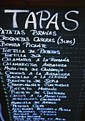 Tapas menu on blackboard in a bar