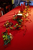 Christmas table decoration with ivy and rose hips