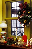 Window sill in a country house with Christmas decorations