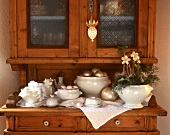 White crockery with Christmas decoration on kitchen cabinet