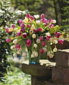 Colourful bunch of tulips in a vase in open air