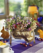 Easter lamb mould used as flower container on table