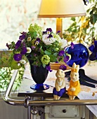 Two Easter Bunnies and bunch of flowers on cooker