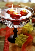 Apple-shaped floating candles as table decoration