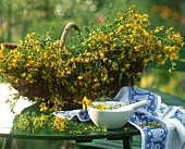 St. John's wort in a basket and a mortar