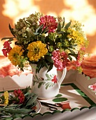 Bouquet of herbs and flowers in a vase