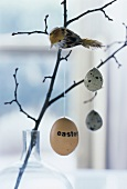 Easter decoration: branch with eggs and bird