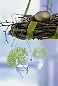 Willow wreath with hanging vase as Easter decoration
