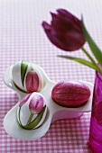 Eggcups with three eggs and purple tulip