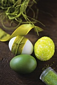 Three Easter eggs: painted, with beads and with bow