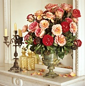 Bouquet of roses on a ledge in front of a mirror
