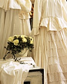 Arrangement of roses and white dress in baroque style