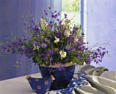 Colourful bouquet in blue ceramic pot