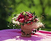 Cheerful table arrangement of Bellis and ivy