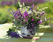 Fragrant bouquet of herbs in ceramic container