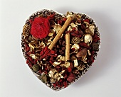 Heart with dried flowers and cinnamon sticks