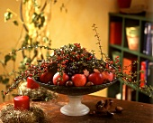 Fruit bowl with apple and sprigs of cotoneaster