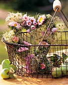 Heart-shaped autumn arrangement of pink asters and gypsophila