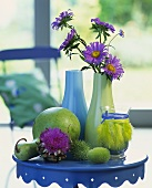 Autumn decoration: ornamental gourds, artichoke flower & asters