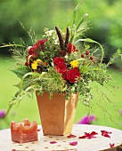 Bouquet of summer flowers with grasses