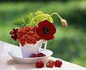 Table decoration: mixed flowers in a coffee cup