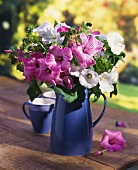 Bouquet of mallow in blue jug
