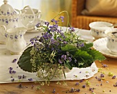 Spring arrangement of forget-me-nots on coffee table