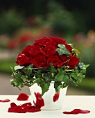 Arrangement of red roses and trailing ivy