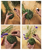 Making an arrangement of poppies and balls of moss