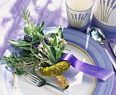 Small bunch of herbs as plate decoration
