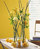 Arrangement of lemons, Peruvian lilies & yellow carnations