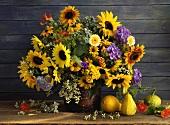 Autumnal bouquet of sunflowers, hydrangeas, Echinacea etc.