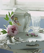 Porcelain tableware with hydrangea on a tray