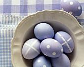 Six purple Easter eggs on a plate