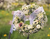 A wreath of anemones, Gypsophila, Ranunculus & marguerites